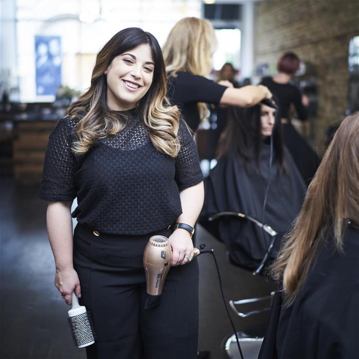 hairdresser-holding-brush-and-dryer