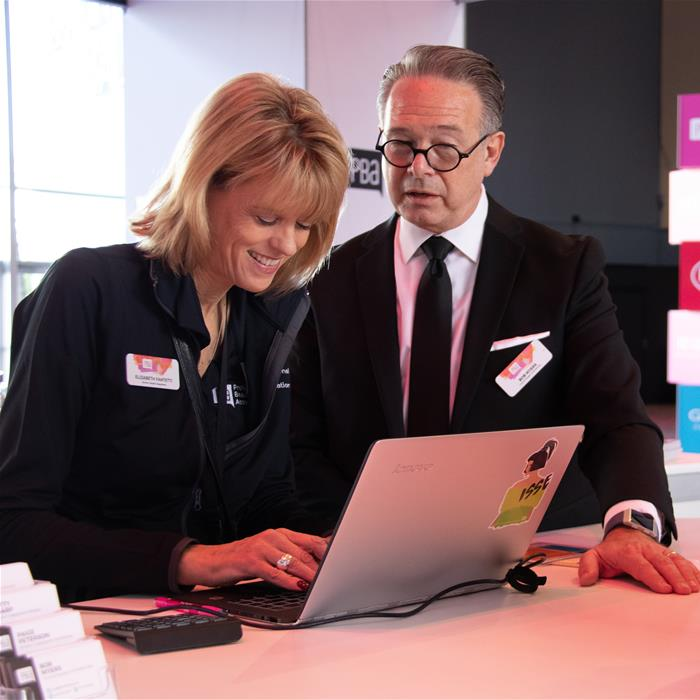 Two PBA employees looking at a laptop