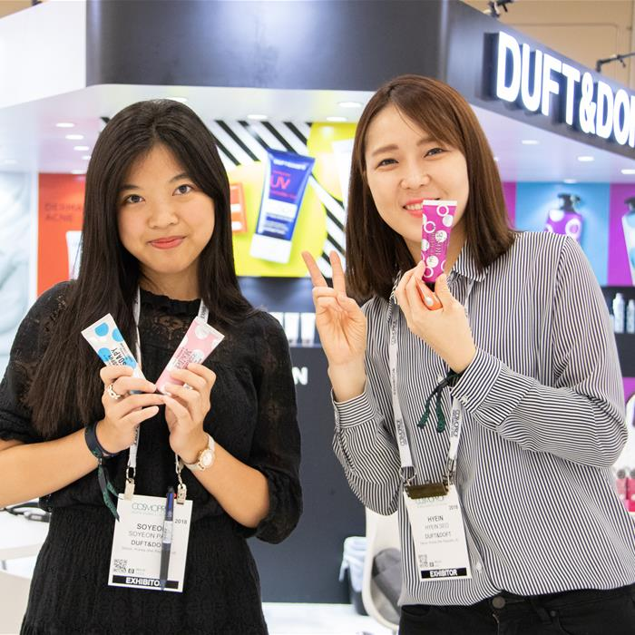 Two CPNA exhibitors posing with their products