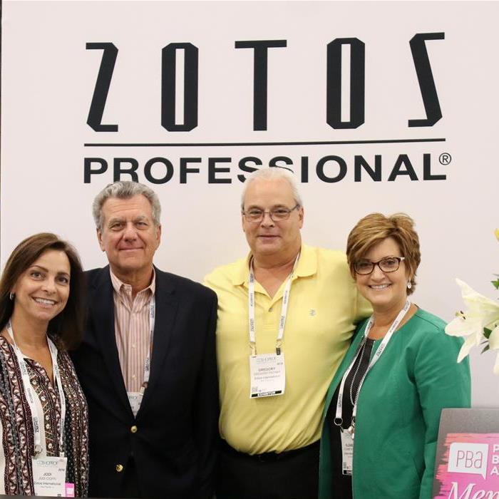 Four members of the Zotos team stand at their booth at CPNA 2018